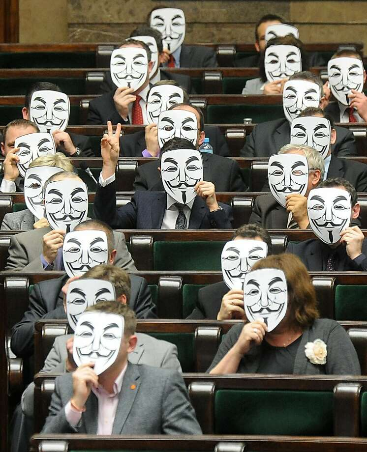 Who are those Guys? Lawmakers of the leftist Palikot's Movement cover their faces with Guy Fawkes masks as they protest Poland's signing of the Anti-Counterfeiting Trade Agreement during a parliament session in Warsaw. Photo: Alik Keplicz, Associated Press