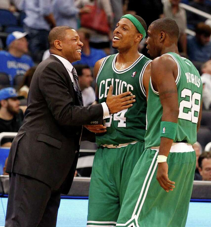 Celtics coach Doc Rivers (left) and Paul Pierce (center) had plenty to smile about in the second half. Photo: AP