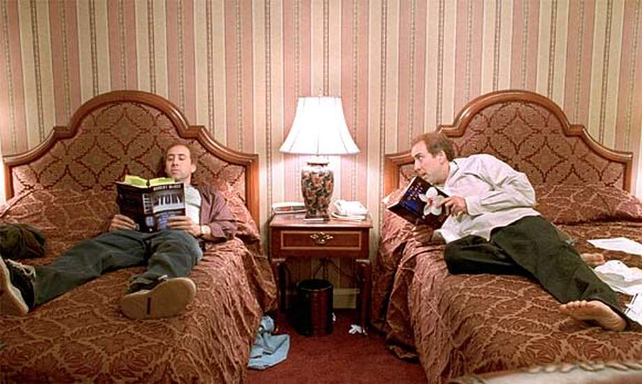 "In ""Adaptation,"" Nicolas Cage plays twin brothers Charlie (left) and Donald Kaufman, who are both trying to write a screenplay. Photo courtesy of Columbia Pictures"