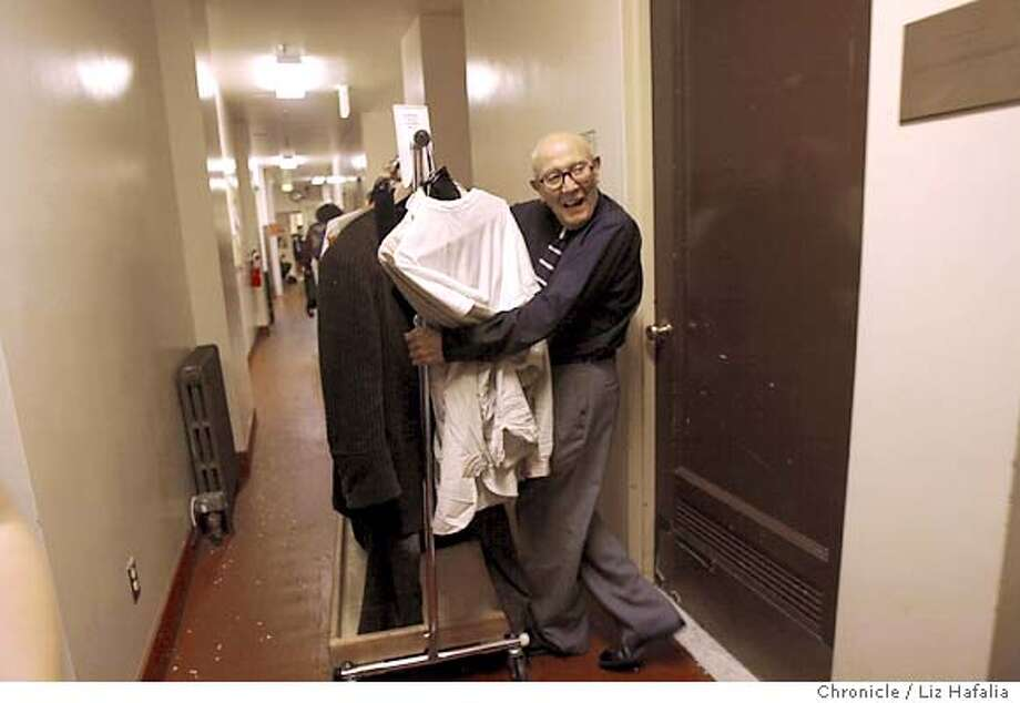 "Joe Harris, a dresser at the SF Opera retiring after 44 years, is putting away the costumes of lead tenor Frank Lapardo (recheck name spelling) who's singing Rodolfo in ""La Boheme."" San Francisco on 6/24/04 by LIZ HAFALIA Photo: LIZ HAFALIA"