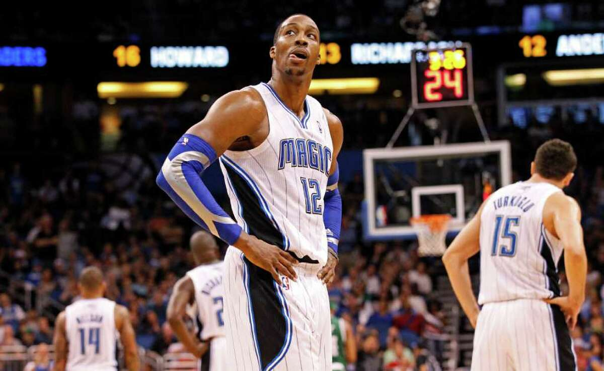 Orlando Magic's Dwight Howard (12) reacts during the second half of an NBA basketball game against the Boston Celtics, Thursday, Jan. 26, 2012, in Orlando, Fla. The Celtics won 91-83. (AP Photo/Mike Carlson)