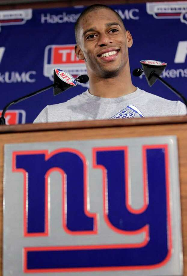 New York Giants wide receiver Victor Cruz talks to the media after NFL football practice, Thursday, Jan. 26, 2012, in East Rutherford, N.J. The Giants will face the New England Patriots in the Super Bowl on Feb. 5 in Indianapolis.  (AP Photo/Julio Cortez) Photo: Julio Cortez