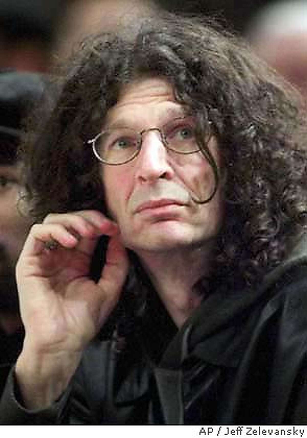 ** FILE ** Howard Stern attends a New York Knicks game at Madison Square Garden in New York, Saturday, Dec. 8, 2001. The Federal Communications Commission has reached a nearly $2 million settlement with Clear Channel Communications to resolve a number of indecency complaints that include shock jock Howard Stern, (AP Photo/Jeff Zelevansky) DEC. 8, 2001 PHOTO