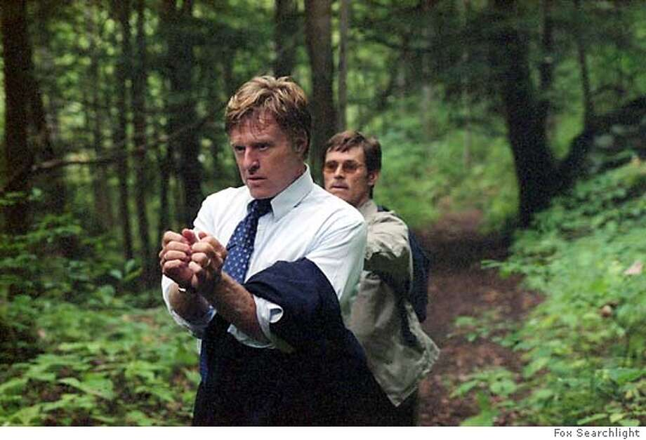 "A wealthy executive (Robert Redford) is kidnapped by a disgruntled employee (Willam Dafoe) and held captive in a forest in "" The Clearing."" (AP Photo/Fox Serchlight)"