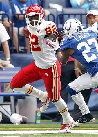 Kansas City Chiefs wide receiver Dwayne Bowe, left, straight arms Indianapolis Colts cornerback Jacob Lacey in the second quarter of an NFL football game in Indianapolis, Sunday, Oct. 9, 2011. (AP Photo/AJ Mast) Photo: AJ Mast, Associated Press