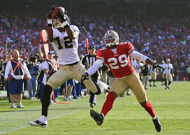 New Orleans Saints wide receiver Marques Colston (12) catches a 25-yard touchdown reception over San Francisco 49ers cornerback Chris Culliver (29) during the second quarter of an NFL divisional playoff football game Saturday, Jan. 14, 2012, in San Francisco.  (AP Photo/Marcio Jose Sanchez) Photo: Marcio Jose Sanchez, Associated Press