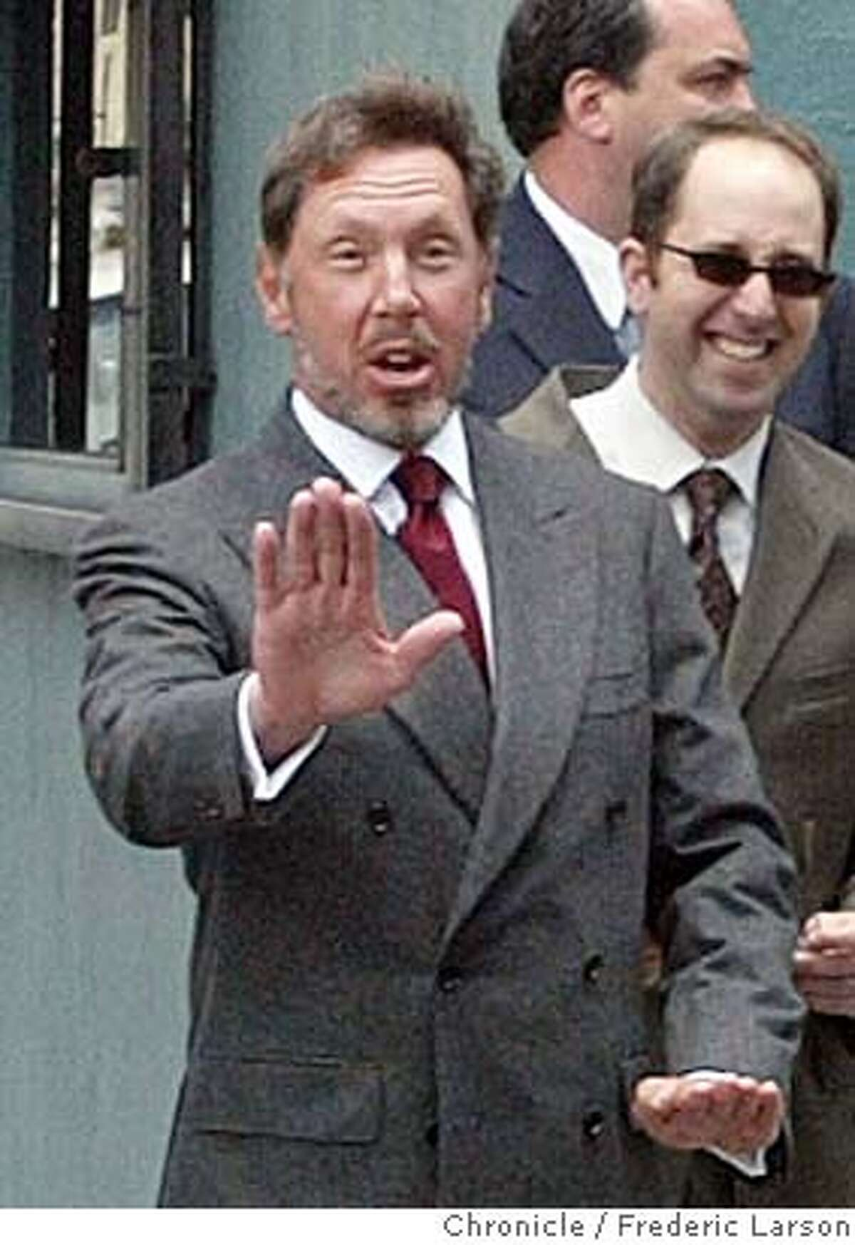 ORACLE_013_fl.jpg; Oracle CEO Larry Ellison directs safety skills to a group of photopraphers as he crosses Larkin at Turk Street before enting the San Francisco Federal Court House to testify for the on going Oracle antitrust. 6/30/04 San Francisco Chronicle Frederic Larson
