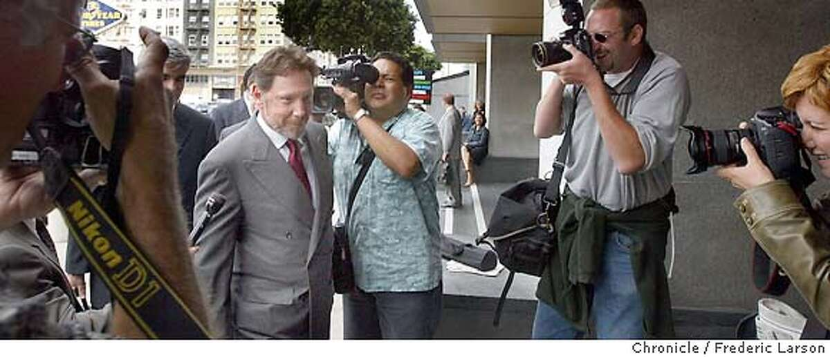 ; CEO Larry Ellison of Oracle makes his way through the photojournalist as he enters the San Francisco Federal Court House on Turk Street to testify for the on going Oracle antitrust. 6/30/04 San Francisco Chronicle Frederic Larson