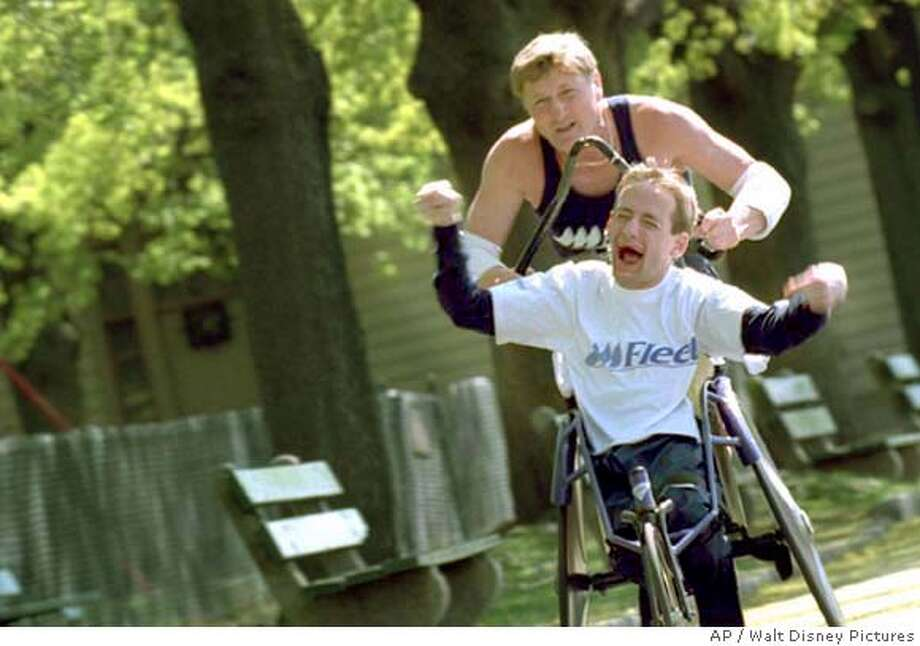 "(top to bottom) Dick and Rick Hoyt are featured in Filmmaker Louis Schwartzberg's ""America's Heart and Soul,"" A film that captures ordinary Americans with extraordinary stories. (AP Photo/Walt Disney Pictures )"