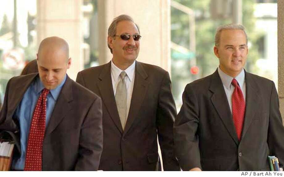 Scott Peterson's attorney Mark Geragos, center, with Nareg Gourjian, associate attorney, left, and associate attorney Pat Harris, right, at the San Mateo County Courthouse in Redwood City, Calif., Tuesday June 29, 2004. Scott Peterson, of Modesto, Calif., could face the death penalty if he's convicted of two counts of murder for the deaths of his wife, Laci Peterson, 27, and the couple's unborn son. (AP Photo/ Bart Ah You, Pool) Pool Photo Photo: BART AH YOU