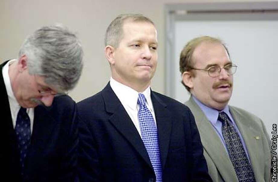 Photo of Alex Popov (center) standing just before the judge enters the court room. Judge Kevin McCarthy announces a ruling on the record hitting home run number 73 by Barry Bonds on October 7, 2001. The court case of Alex Popov, Plaintiff vs. Patrick Hayashi, Defendant. The judge ruled that the ball must be sold and the proceeds divided equally between the parties.  Photo by Craig Lee/San Francisco Chronicle Photo: CRAIG LEE