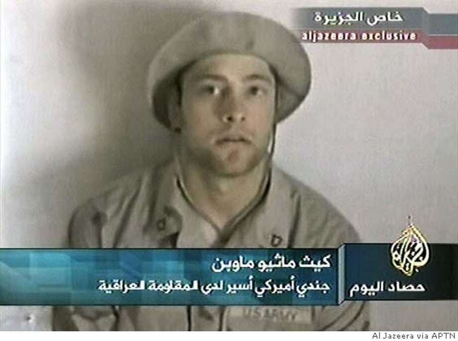 **FILE** Kidnapped American soldier Pfc. Keith M. Maupin, of Batavia, Ohio is seen in this undated file image made from video broadcast by Arab television station Al-Jazeera on April 16, 2004. Al-Jazeera television said Tuesday, June 29, 2004, that Iraqi militants have killed Maupin, an American soldier they have held hostage since early April, because the U.S. government did not change its policy in Iraq. Maupin was captured in April 2004 during an ambush on a convoy west of Baghdad. (AP Photo/Al Jazeera via APTN, File) ** TV OUT GERMANY OUT **