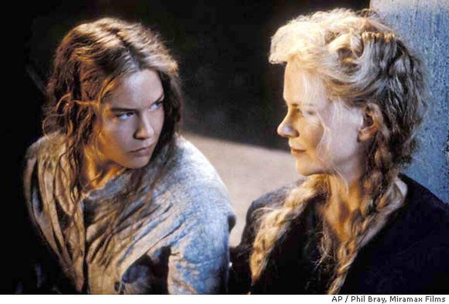 "Actors Renee Zellweger, left, and Nicole Kidman appear in a scene from Miramax Films' ""Cold Mountain in this undated promotional photo. Zellweger was nominated for best supporting actress, Tuesday, Jan. 27, 2004, for her role in the film but the Civil War saga failed to get nominations for best picture, director Anthony Minghella, or lead actress Nicole Kidman. (AP Photo/Miramax Films, Phil Bray) UNDATED HANDOUT PHOTO, Photo: PHIL BRAY"