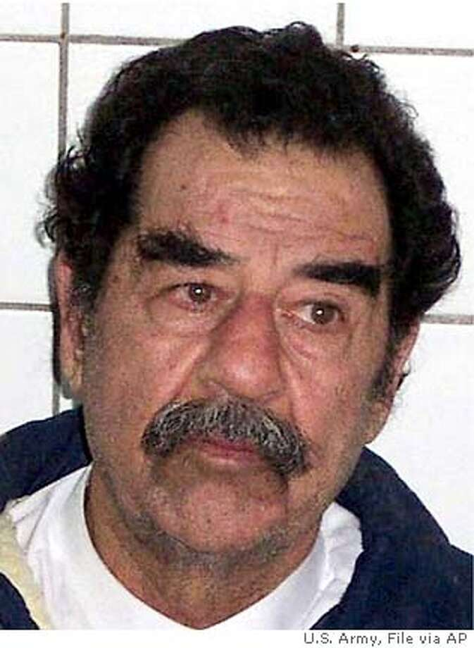 ** FILE ** In these images released by the U.S. Army on Dec. 14, 2003 former Iraqi President Saddam Hussein is shown before and after his beard was shaved in custody after he was arrested near his Tikrit home. The new Iraqi government wants custody of Saddam Hussein and all other prisoners by the time sovereignty is handed over at the end of this month, the interim prime minister Iyad Allawi said Monday, June 14, 2004. (AP Photo/U.S. Army, HO) ** **
