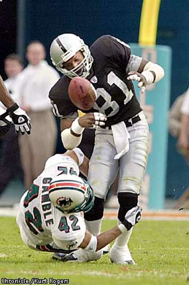 Trent Gamble with the hit on Tim Brown he fumbled the ball in the 4th The Miami Dolphans Vs The Oakland Raiders .Photo By Kurt Rogers Photo: Kurt Rogers