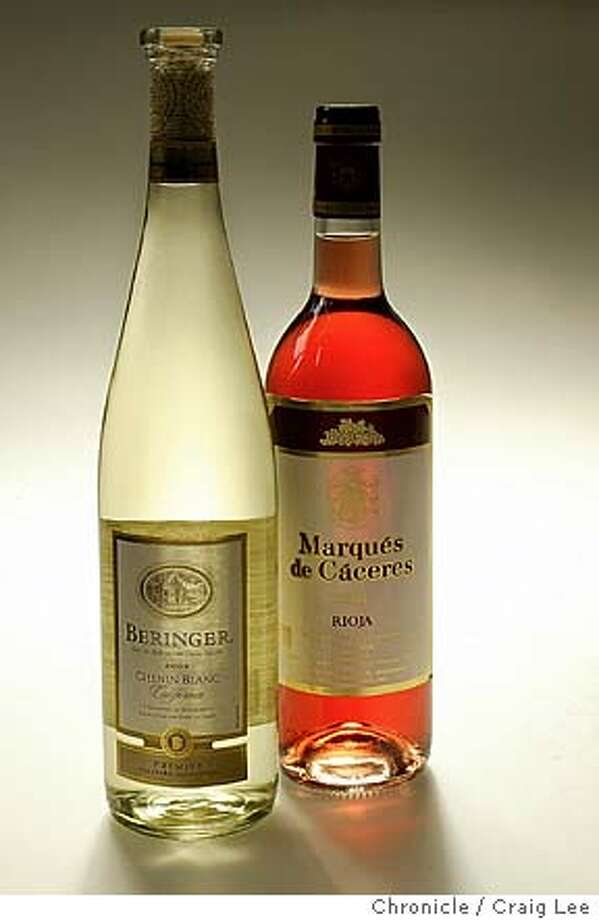 Bargain Wines column photo. 2003 Beringer Chenin Blanc (left) and 2003 Marques de Caceras Rioja Rose (right).  Event on 6/24/04 in San Francisco. Craig Lee / The Chronicle Photo: Craig Lee