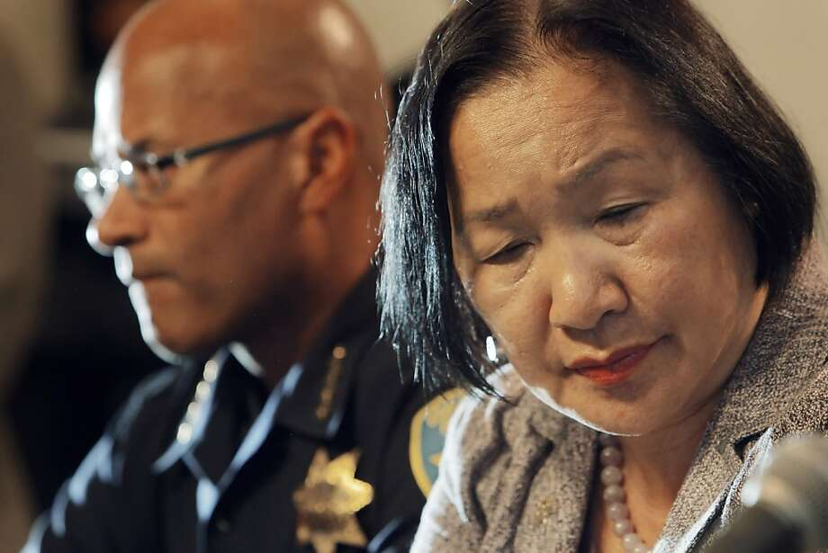 Oakland Mayor Jean Quan, right, listens to City Administrator Deanna Santana, off camera, answers a question during a press conference at City Hall in Oakland, Calif, on Wednesday, October 26, 2011. Quan, interim Police Chief Howard Jordan, left, and Santana anwered questions, Wednesday, after police used tear gas and non-lethal weapons against demonstrators from the Occupy Oakland group the previous night. Photo: Carlos Avila Gonzalez, The Chronicle