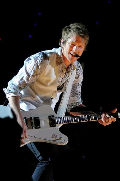Lead guitarist Joe Don Rooney performs with Rascal Flatts on Thursday, Jan. 26, 2012, at Times Union