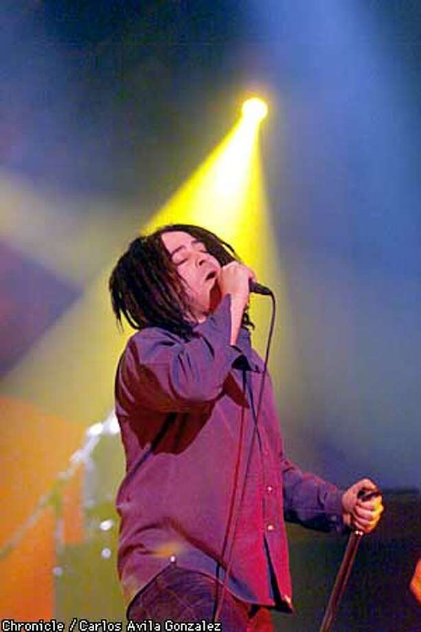 CROWS03/C/12DEC99/DD/CG --- Counting Crows lead singer, Adam Duritz, performs at the Warfield Theater in San Francisco, Ca., on Sunday night, December 12, 1999. BY CARLOS AVILA GONZALEZ/THE CHRONICLE