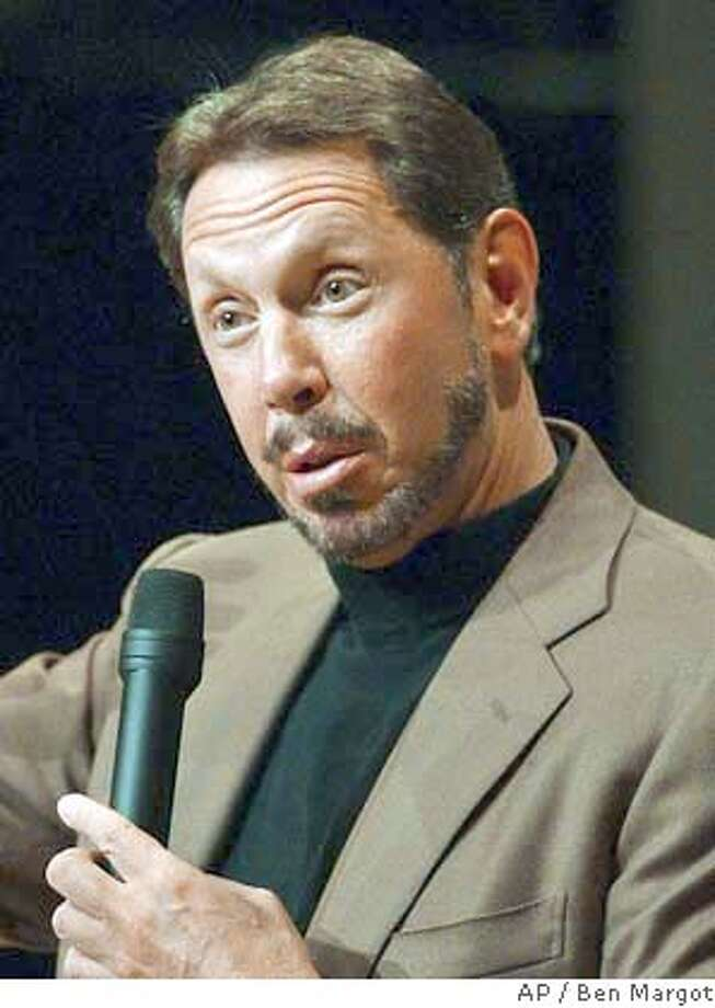 ** FILE ** Oracle Corp. chief executive Larry Ellison fields questions from financial analysts Wednesday, July 9, 2003, during Financial Analyst Day at Oracle headquarters in Redwood Shores, Calif. Ellison Has decided to fight a Justice Department lawsuit blocking his company's $9.4 billion bid for PeopleSoft Inc. (AP Photo/Ben Margot) Dell Chairman Dell Chairman ProductName	Chronicle Photo: BEN MARGOT