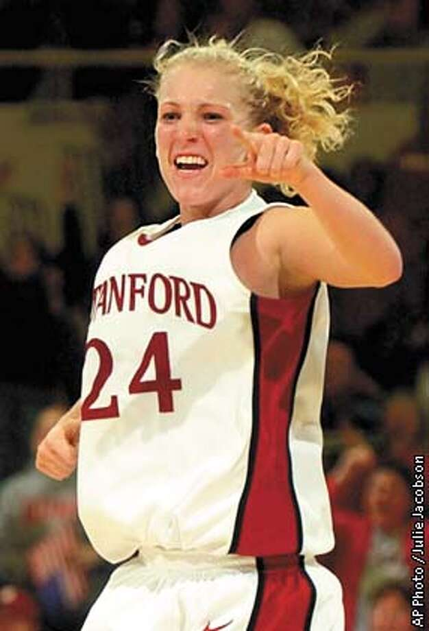 Stanford's Susan King celebrates after hitting a 3-point shot in the second half against Kansas State on Saturday, Nov. 30, 2002 in Stanford, Calif. King's 14 points helped Stanford to a 63-57 win in the championship game of the Stanford Tournament. (AP Photo / Julie Jacobson) Photo: JULIE JACOBSON