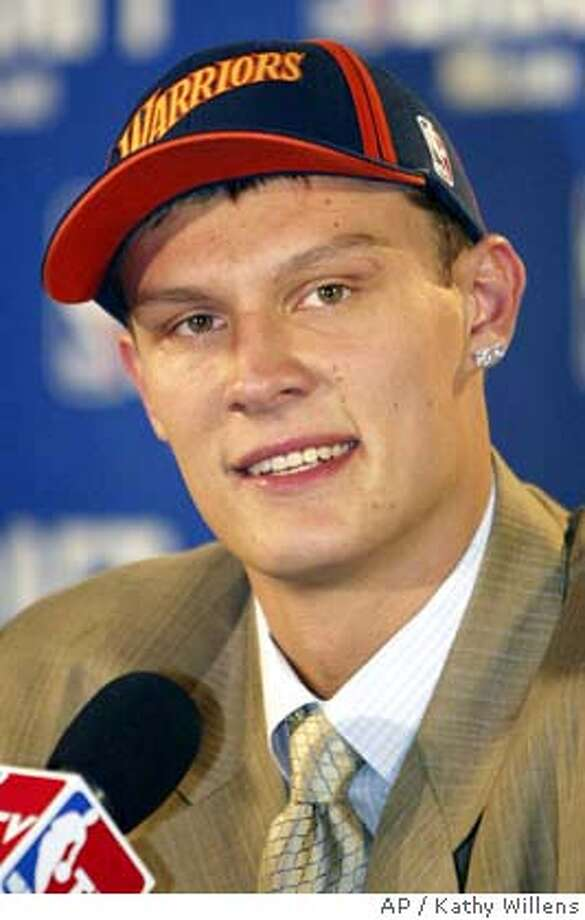 Andris Biedrins, of Latvia, reacts at a news conference after he is chosen by the Golden State Warriors as the eleventh overall pick of the 2004 Thursday, June 24, 2004 in New York. (AP Photo/Kathy Willens) Photo: KATHY WILLENS