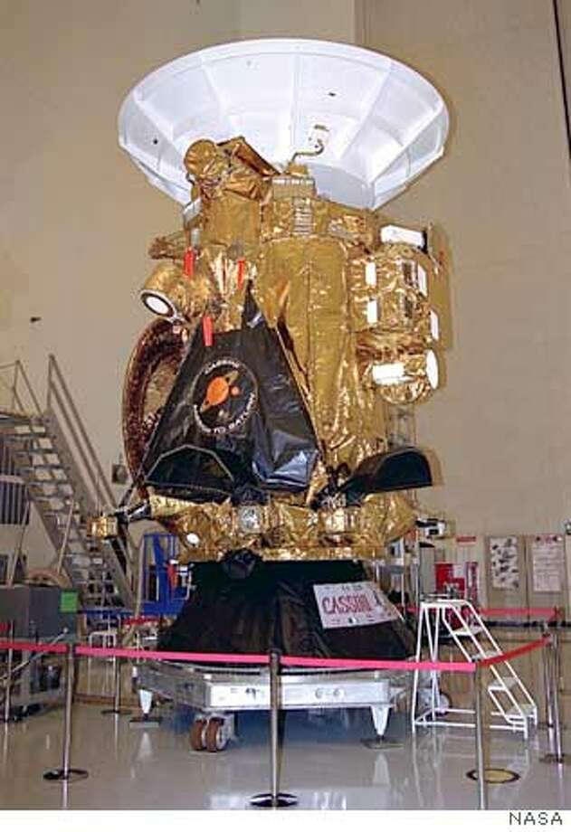 File photo showing the Cassini spacecraft sits on display for the media in the Payload Hazardous Servicing Facility at the Kennedy Space Center, in August of 1997. Cassini is a cooperative project of NASA, the European Space Agency and the Italian Space Agency. The Jet Propulsion Laboratory, a division of the California Institute of Technology in Pasadena, manages the Cassini mission for NASA's Office of Space Science, Washington. The Cassini spacecraft is due to arrive and orbit the planet Saturn on June 30, 2004. B&W ONLY REUTERS/NASA/JPL/Space Science Institute/Handout Photo: HO