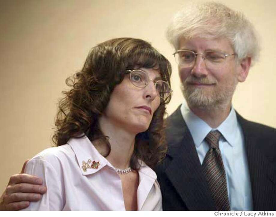 Angel McClary Raich, plaintiff and her husband and attorney Robert Raich, in the California medical marijuana case during a news conference, in Oakland, to address U.S. Supreme Court�s announcement today that it will review a Ninth Circuit Court of Appeals ruling on the case, Monday June 28, 2004. LACY ATKINS / The Chronicle Photo: LACY ATKINS