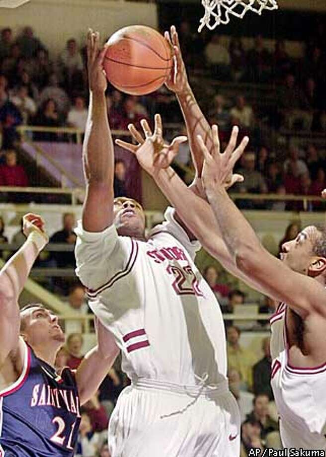 Stanford forward Justin Davis goes up for the rebound in front of St. Mary's guard Tyler Herr, left, and Stanford center Rob Little, right, in the first half, Saturday, Dec. 14, 2002 in Stanford, Calif. (AP Photo/Paul Sakuma) Photo: PAUL SAKUMA