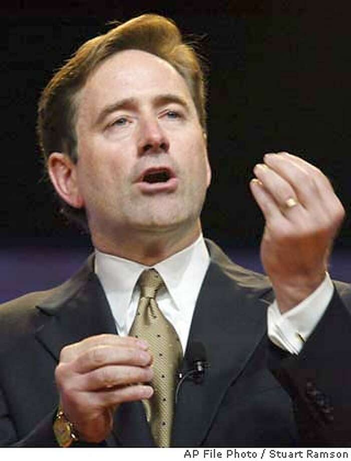 **FILE** Craig A. Conway, president and chief executive officer of PeopleSoft, Inc., is shown in New York, in this June 19, 2003, file photo. Business software maker PeopleSoft Inc. threw a curve ball at unwelcome suitor Oracle Corp. late Friday, Jan. 30, 2004, by accelerating a pivotal shareholder vote that will determine its board of directors. Conway is one of four incumbent directors PeopleSoft wants its shareholders to re-elect in order to preserve the status quo on an eight-member board that has already twice rejected Oracle's overtures. (AP Photo/Stuart Ramson, File) ALSO RAN: 03/18/2004 ProductName	Chronicle Craig Conway, PeopleSoft CEO, wants to stop takeover. Craig Conway, PeopleSoft CEO, wants to stop takeover. CEO Craig Conway is up for re-election as a director at PeopleSoft's shareholder meeting today. Conway Conway JUNE 19, 2003 FILE PHOTO Photo: STUART RAMSON