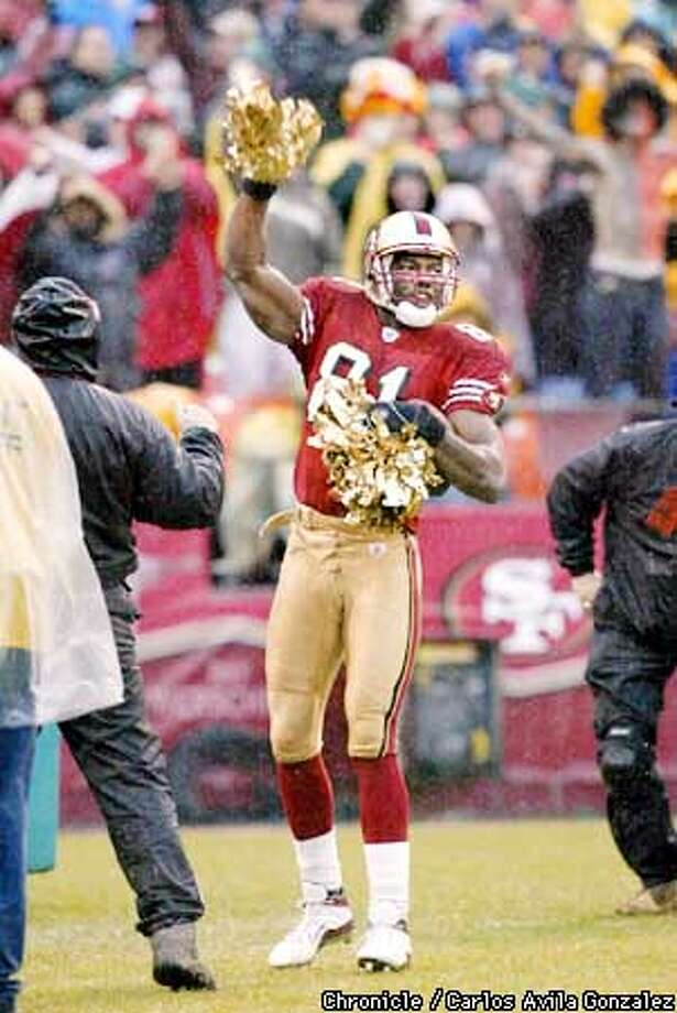 Terrell Owens celebrates his third quarter touchdown. The San Francisco 49ers lost to the Green Bay Packers at Candlestick Park on Sunday, December 15, 2002.  (PHOTO BY CARLOS AVILA GONZALEZ/THE SAN FRANCISCO CHRONICLE) Photo: CARLOS AVILA GONZALEZ