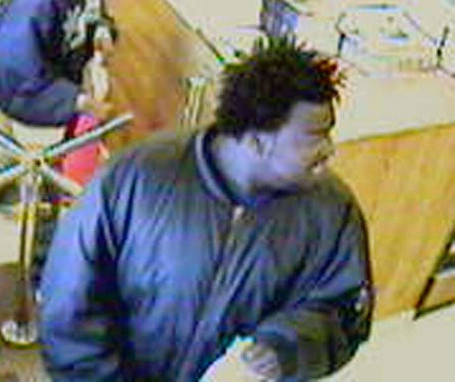 Photo of Kaenya Taylor, 24.  NOTE: these photos were taken by a neighborhood security camera by a friend who owned the store while they were having lunch.
