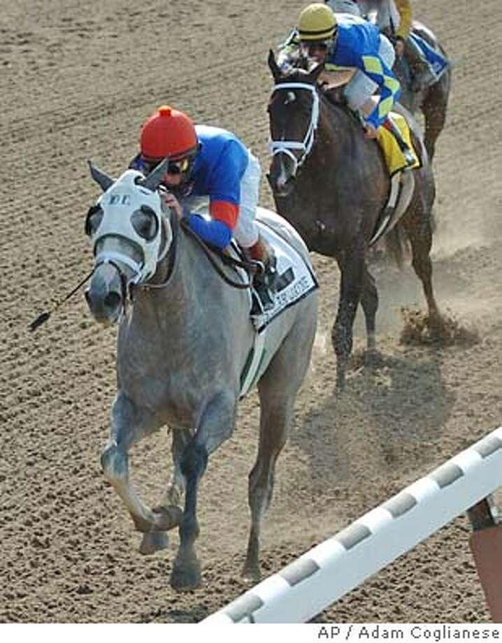 Stellar Jayne, with jockey Robby Albarado, captures the Mother Goose Stakes at Belmont Park on Saturday, June 26, 2004, in Elmont, N.Y. Ashado was second with jockey John Velazquez. (AP Photo/New York Racing Association, Adam Coglianese) Photo: ADAM COGLIANESE