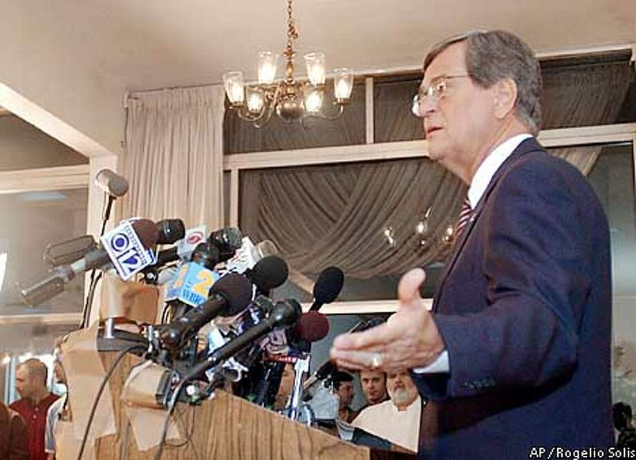 U.S. Sen. Trent Lott, R-Miss., talks with reporters during a news conference in Pascagoula, Miss., on Friday, Dec. 13, 2002. Lott once again apologized for remarks he made during a birthday celebration for retiring U.S. Sen. Strom Thurmond. (AP Photo/Rogelio Solis) Photo: ROGELIO SOLIS
