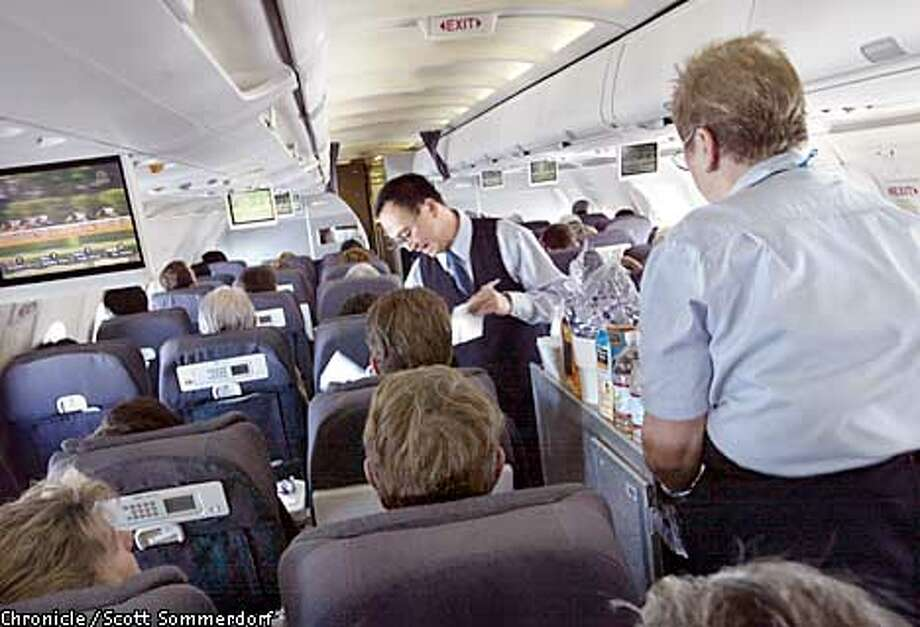 UNITED-c-18AUGAUG02-TR-SS United airlines flight crew serve passengers drinks on a flight from Vancouver Canada to San Francisco International Airport. United Airlines seems to be in some dire financial times, and may be on the edge of filing for Chapter 11 soon. (SF CHRONICLE PHOTO BY SCOTT SOMMERDORF)