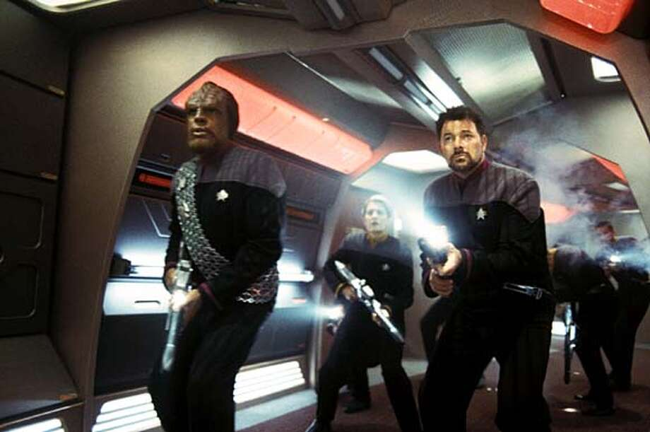 "Lt. Cmdr. Worf (Michael Dorn, left) and Cmdr. William Riker (Jonathan Frakes) come out firing in ""Star Trek: Nemesis."""