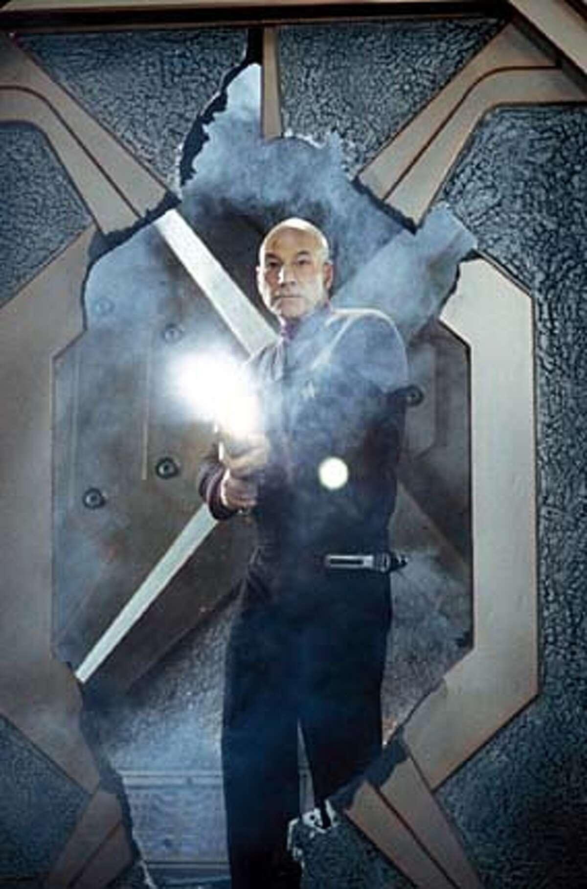 "Jean-Luc Picard (Patrick Stewart) fires away in ""Star Trek: Nemesis."""