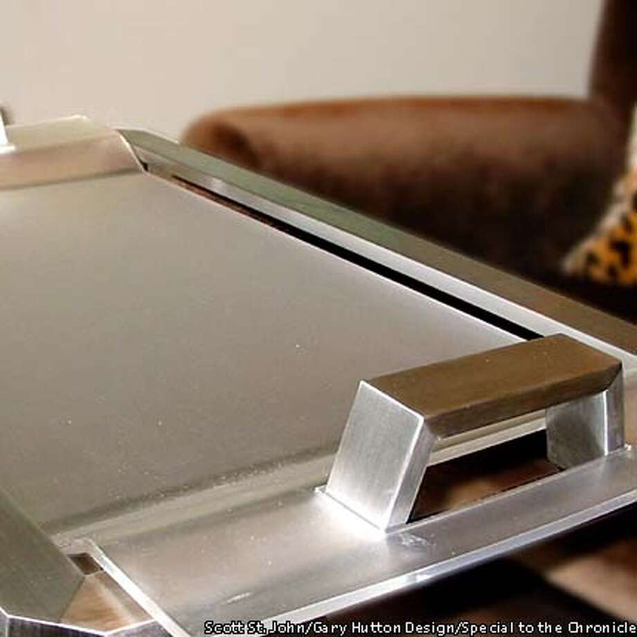 Stainless steel and frosted plastic give trays a sleek look. Gary Hutton Design photo by Scott St. John, special to the Chronicle