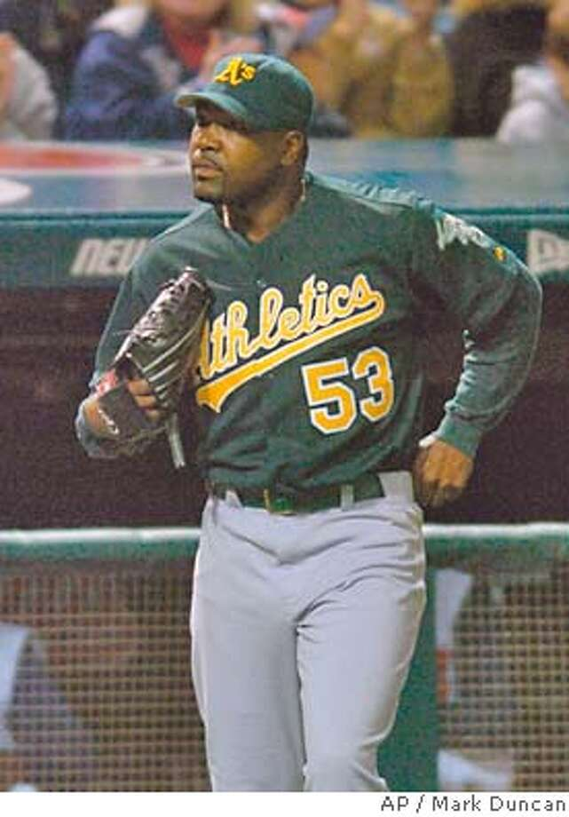 Oakland Athletics pitcher Arthur Rhodes walks back to the mound after giving up a single to Cleveland Indians Travis Hafner to drive in the go-ahead run in the eighth inning Saturday, May 29, 2004, in Cleveland. Rhodes came into the game with a one-run lead, but Cleveland scored three runs in the inning and went on to win 8-6. (AP Photo/Mark Duncan) A's closer Arthur Rhodes couldn't get the job done in the eighth inning, turning a one-run lead into a two-run deficit. A's closer Arthur Rhodes couldn't get the job done in the eighth inning, turning a one-run lead into a two-run deficit. Photo: MARK DUNCAN