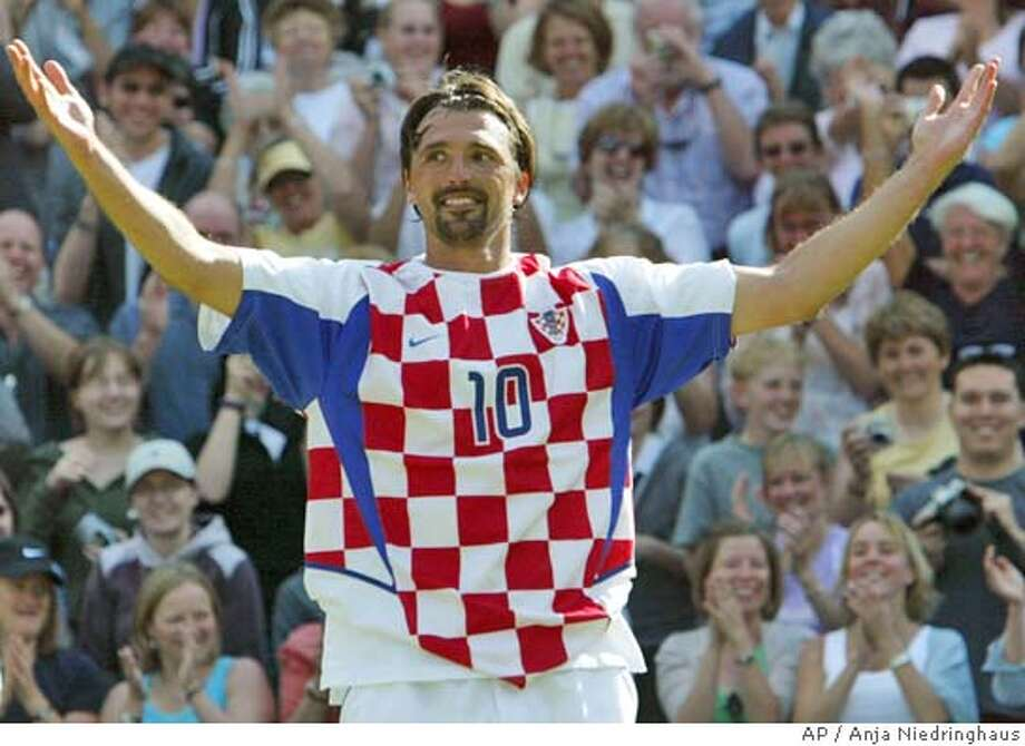 Former champion Goran Ivanisevic wears a Croation soccer shirt, after his defeat by Australia's Lleyton Hewitt, in their Men's Singles, third round match on the Centre Court at Wimbledon, Friday June 25, 2004. Leyton defeated Ivanisevic, who had already announced his retirement, 6-2, 6-3, 6-4.(AP Photo/Anja Niedringhaus) ** EDITORIAL USE ONLY ** Photo: ANJA NIEDRINGHAUS