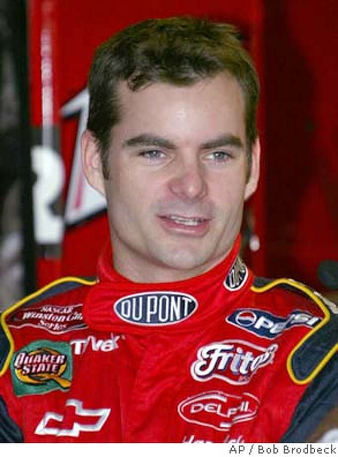 Jeff Gordon talks in the garage area prior to qualifications for the NASCAR Sirius Satellite Radio 400 at Michigan International Speedway in Brooklyn, Mich., Friday, June 13, 2003. Gordon has reached a divorce settlement that guarantees his former wife at least $15.3 million. Brooke Gordon waived alimony and will get the money from the sale of two properties, including the couple's oceanfront home in Highland Beach, according to court documents. (AP Photo/Bob Brodbeck) cat JUNE 13, 2003 FILE PHTO Photo: BOB BRODBECK
