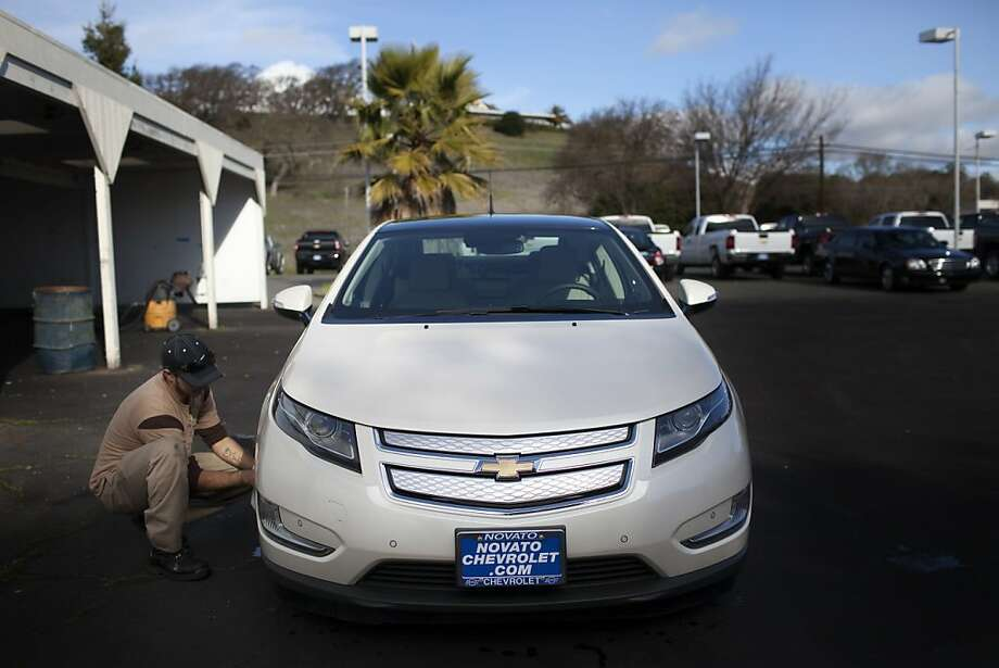 Car detailer Daniel Gonzales washes a low-emission Chevy Volt at Novato Chevrolet. The state is encouraging the development of such hybrid cars. Photo: Dania Maxwell, Special To The Chronicle