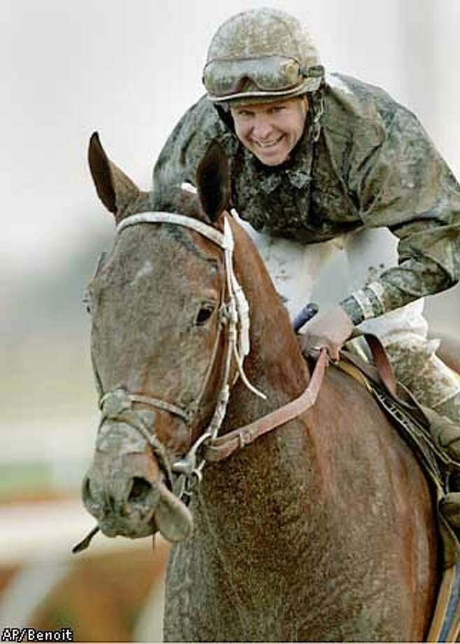Debonair Joe, ridden by Julie Krone, returns to the winner's circle after winning the Grade III Vernon O. Underwood Stakes Saturday, Dec. 7, 2002, at in Inglewood, Calif. (AP Photo/Benoit Photo)