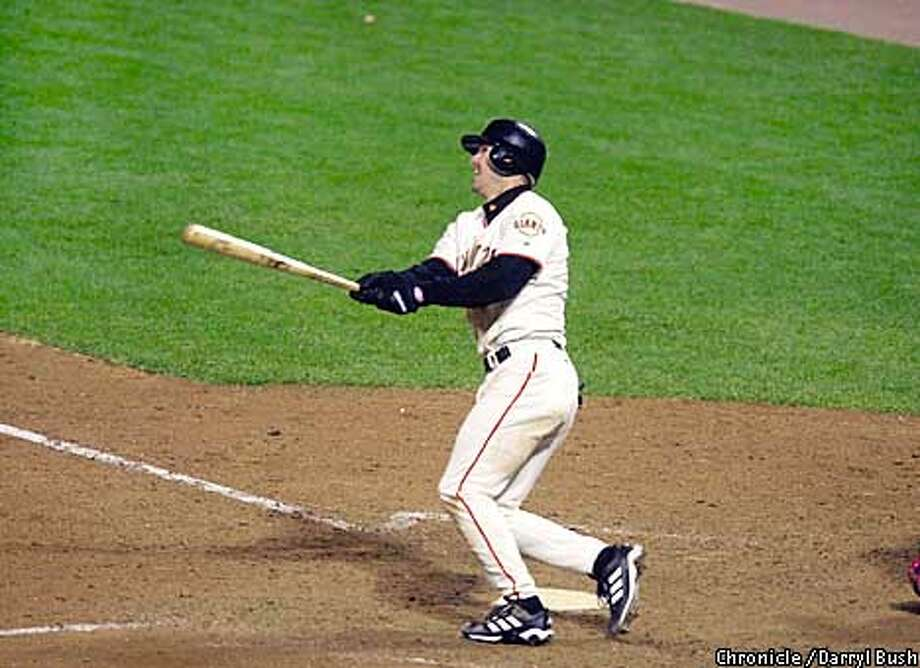 GIANTS51-C-24OCT02-SP-DB --- Jeff Kent watches hi home run jump out of the stadium to left field to make the score 8-4. The San Francisco Giants play the Anaheim Angels in Games 5 of the World Series at Pac Bell Park in San Francisco, Ca. October 24, 2002. Darryl Bush/San Francisco Chronicle