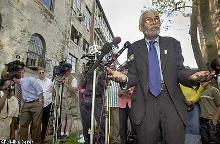 **FILE**Amiri Baraka, New Jersey's poet laureate, gestures during a news conference outside the Newark Public Library in Newark, N.J., in this Oct. 2, 2002, file photo. Baraka, 68, defended a poem he wrote implying that Israel knew in advance of the Sept. 11 terrorist attacks, and again rebuffed the demand of New Jersey Gov. James E. McGreevey that he resign and apologize. The media attention being paid to Baraka is unusual for poets laureate, who usually function as nonpartisan advocates. (AP Photo/Mike Derer) Photo: MIKE DERER
