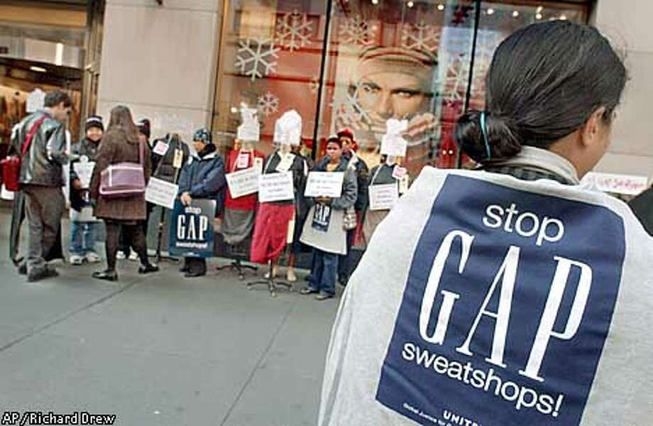 Gap clothing plant workers from several countries participate in a demonstration outside a Gap store on New York's Fifth Ave., Wednesday, Nov. 20, 2002, to protest low pay and working conditions. (AP Photo/Richard Drew) Photo: RICHARD DREW