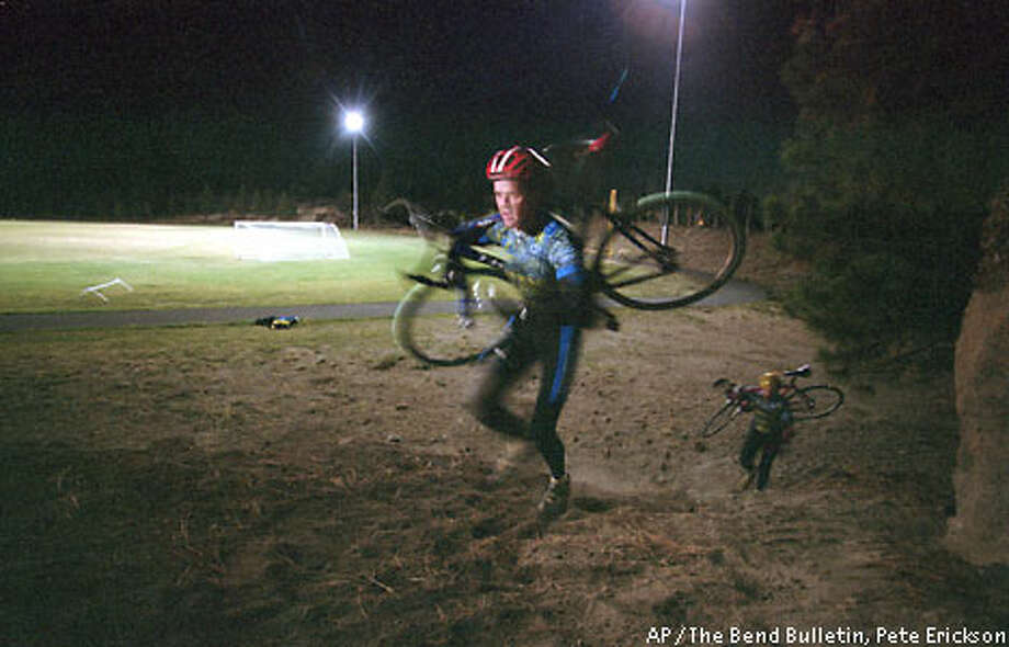 Cyclocross competitors often find it is faster to carry their bike across certain obstacles than it is to pedal. Associated Press photo by Pete Erickson
