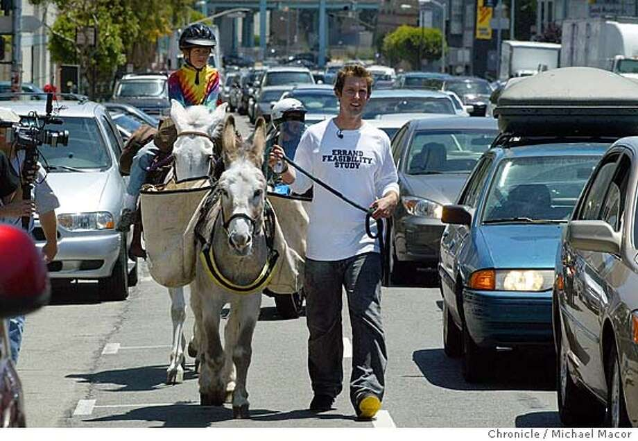 "Marc leadds, ""Hail"" as Adeline Jones, 11 rides atop ""Audrey"" as they make their way up 9th st. south of Market. Adeline's dad owns the animals. San Francisco performance artist Marc Horowitz spends the day riding a mule to take him to his various errands he needed to get done. As part of his ""Errand Fesability Study"". event on 6/12/04 in San Francisco Michael Macor/San Francisco Chronicle Photo: Michael Macor"