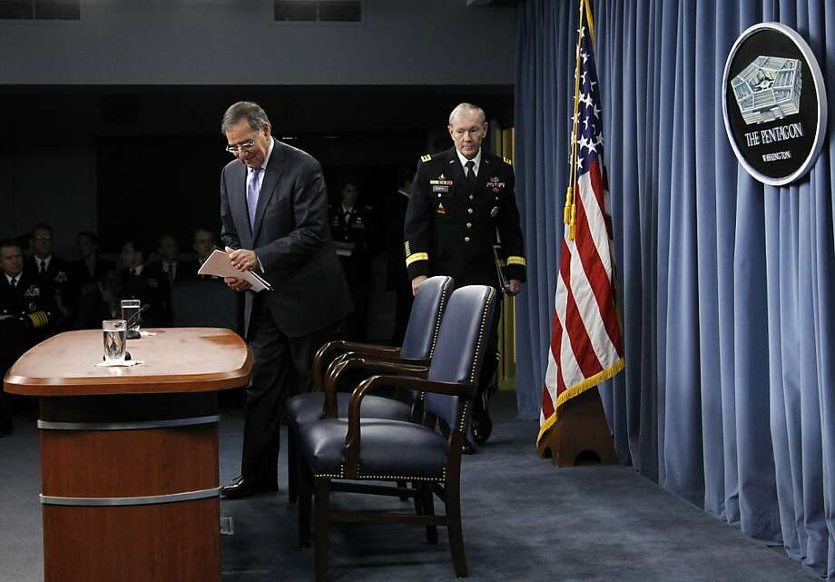 Defense Secretary Leon Panetta, left, and Joint Chiefs Chairman Gen. Martin E. Dempsey, arrive for a news conference at the Pentagon, Thursday, Jan. 26, 2012, where Panetta outlined the main areas of proposed spending cuts. (AP Photo/Pablo Martinez Monsivais) Photo: Pablo Martinez Monsivais, Associated Press