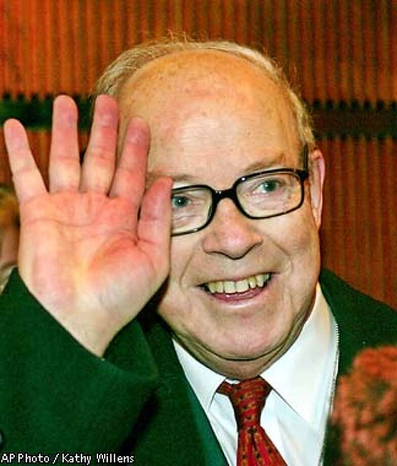 Chief UN weapons inspector Hans Blix waves to the media as he enters the elevators at the United Nations Tuesday, Dec. 10, 2002, in New York. He is expected to brief Security Council members in a private luncheon meeting at the UN.(AP Photo/Kathy Willens) Photo: KATHY WILLENS